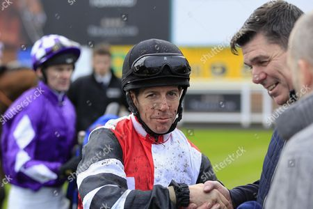 Jim Crowley is congratulated by Mick Quinn after Great Hall had won the Kier Living Handicap at Nottingham.