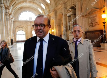 USA's Guy Wildenstein, right, arrives with his lawyer Herve Temime at the Paris courthouse, . The heir of a New York art-dealing empire, Guy Wildenstein, goes to court in Paris on Thursday for allegedly hiding his family fortune for years in offshore tax havens, with French authorities demanding a staggering 553 million euros ($621 million) in back taxes