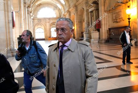 USA's Guy Wildenstein arrives at the Paris courthouse, . The heir of a New York art-dealing empire, Guy Wildenstein, goes to court in Paris on Thursday for allegedly hiding his family fortune for years in offshore tax havens, with French authorities demanding a staggering 553 million euros ($621 million) in back taxes