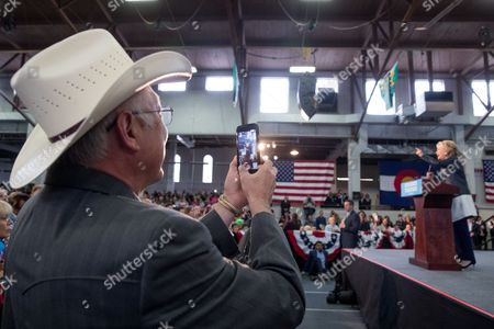 Stock Picture of Hillary Clinton, Ken Salazar Former Senator and Secretary of the Interior Ken Salazar, D-Colo., left, takes a video with his smartphone ofDemocratic presidential candidate Hillary Clinton as she speaks at a rally at the Colorado State Fairgrounds in Pueblo, Colo