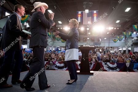 Hillary Clinton, Ken Salazar, Michael Bennet Democratic presidential candidate Hillary Clinton welcomes on stage Sen. Michael Bennet, D-Colo. left, and former Sen. and Secretary of the Interior Ken Salazar, D-Colo., second from left, after speaking at a rally at the Colorado State Fairgrounds in Pueblo, Colo., to attend a rally