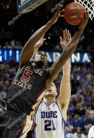 Florida State forward Bernard James (5) works against Duke forward Miles Plumlee (21) during the first half of an NCAA college basketball game in the semifinals of the Atlantic Coast Conference tournament, in Atlanta