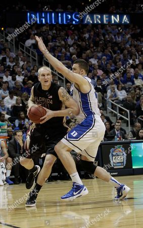 Florida State center Jon Kreft (50) works against Duke forward Miles Plumlee (21) during the first half of an NCAA college basketball game in the semifinals of the Atlantic Coast Conference tournament, in Atlanta