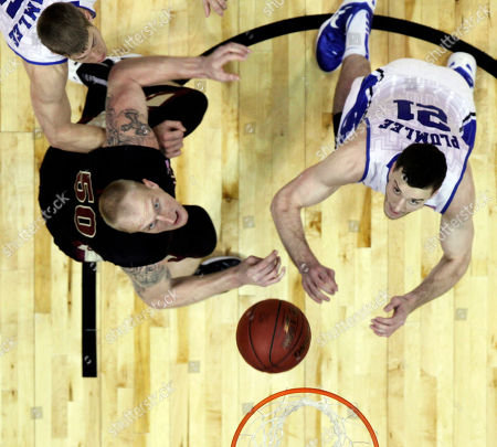 Duke forward Alex Murphy (12) and Florida State center Jon Kreft (50) wait for a rebound as Duke forward Miles Plumlee looks on during the first half of an NCAA college basketball game in the semifinals of the Atlantic Coast Conference tournament, in Atlanta