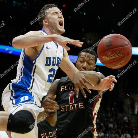 Duke forward Miles Plumlee (21) and Florida State forward/center Xavier Gibson (1) collide during the first half of an NCAA college basketball game in the semifinals of the Atlantic Coast Conference tournament, in Atlanta