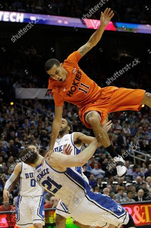 Virginia Tech guard Erick Green (11) looses the ball as Duke forward Miles Plumlee (21) defends during the first half of an NCAA college basketball game in the quarterfinals of the Atlantic Coast Conference tournament, in Atlanta