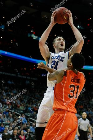 Duke forward Miles Plumlee (21) works against Virginia Tech forward Jarell Eddie (31) during the first half of an NCAA college basketball game in the quarterfinals of the Atlantic Coast Conference tournament, in Atlanta
