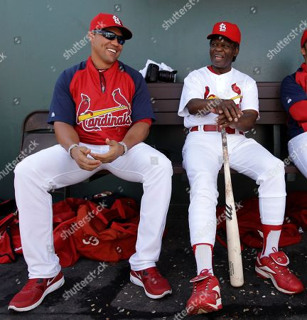 Carlos Beltran, Lou Brock St. Louis Cardinals' Carlos Beltran, left, shares a light moment with former Cardinal Lou Brock during a spring training baseball game against the Houston Astros in Jupiter, Fla