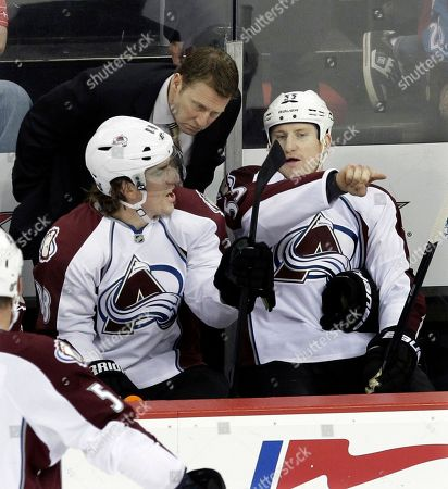 Joe Sacco, Cody McLeod, Peter Mueller Colorado Avalanche head coach Joe Sacco listens to players Cody McLeod, right, and Peter Mueller, left, during the second period of an NHL hockey game against the New Jersey Devils in Newark, N.J., . The Devils won 1-0 in a shootout