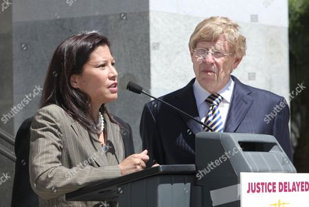 Tan-Canitle-Sakauye, Theodore Olson California Supreme Court Chief Justice Tani Cantile-Sakauye, left, warns that state budget cuts to the court system is making justice inaccessible for average people, during a news conference at the Capitol, in Sacramento, Calif., . Cantil-Sakauye was joined by attorney Theodore Olson, right, who is co-chair of an American Bar Association task force looking into the effect of court cutbacks nationwide