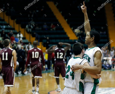 Daniel Kaigler, Matt Rogers Bishop Ludden's Matt Rogers (24) and Daniel Kaigler react after their team's 43-42 win over Watervliet in a New York State Public High School Athletic Association boys' Class B championship basketball game in Glens Falls, N.Y., on