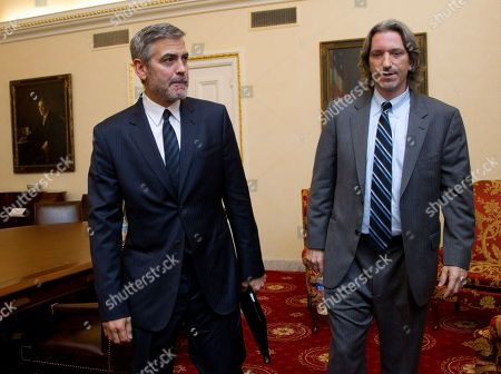George Clooney, John Prendergast Actor George Clooney, left, and John Prendergast, co-founder of the advocacy group Enough Project, leave an interview with The Associated Press, and other news organizations, on Capitol Hill in Washington. Clooney was to testify before the Senate Foreign Relations Committee hearing on Sudan