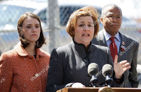 Stock Photo of Christine Quinn, Jessica Lappin, Robert Jackson City Council Speaker Christine Quinn, speaks as city council members Jessica Lappin, left, and Robert Jackson, right, listen during a news conference near the construction site for the 7 line subway extension where a crane collapsed in Manhattan, killing one worker and seriously injuring another, in New York. The collapse is the city's third fatal accident of its kind in four years