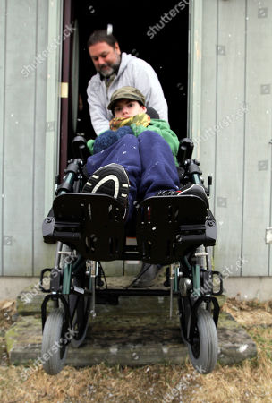 Ethan Kelly, Alden KellyCerebral Palsy Ethan Kelly, age 21, who has cerebral palsy, is wheeled out of his home by his father, Alden Kelly, in Appleton, Maine, on . Ethan's parents, Alden and Lisa Kelly provide full-time care for their son.The Kellys are among the nearly 1,000 families on an ever-growing waiting list for state support services