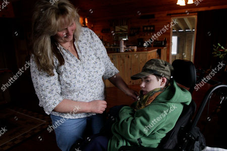 Ethan Kelly, Lisa Kelly,Cerebral Palsy Ethan Kelly, age 21, who has cerebral palsy, gets help from his mother, Lisa Kelly, in Appleton, Maine, on . Ethan's parents, Alden and Lisa Kelly provide full-time care for their son. The Kellys are among the nearly 1,000 families on an ever-growing waiting list for state support services