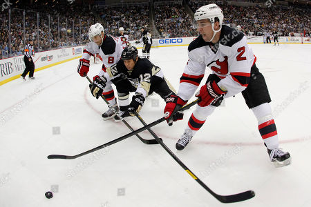 Richard Park, Dainius Zubrus, Marek Zidlicky With a fisheye lens Pittsburgh Penguins' Richard Park (12) works in the corner between New Jersey Devils' Dainius Zubrus (8) and Marek Zidlicky (2) in the second period of an NHL hockey game in Pittsburgh . The Penguins won 5-2