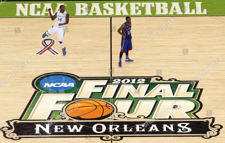 Kentucky's Michael Kidd-Gilchrist (14) celebrates in front of Kansas' Tyshawn Taylor at the end of the NCAA Final Four tournament college basketball championship game, in New Orleans. Kentucky won 67-59
