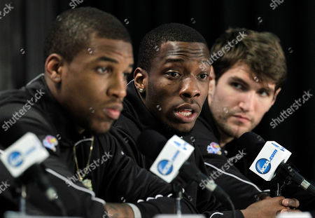 Kansas' Tyshawn Taylor, center, speaks during a news conference for the NCAA Final Four tournament college basketball game as teammates Thomas Robinson, left, and Jeff Withey, right, look, in New Orleans. Kansas plays Kentucky in the championship game Monday night