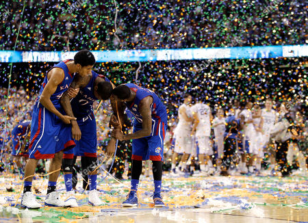 Kansas forward Thomas Robinson (0), guard Tyshawn Taylor (10) and forward Kevin Young, left, after the NCAA Final Four tournament college basketball championship game, in New Orleans. Kentucky won 67-59