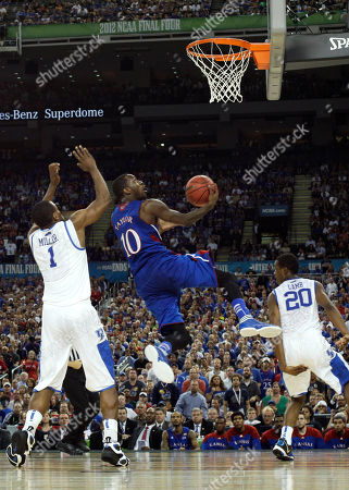 Stock Photo of Kansas' Tyshawn Taylor (10) drives to the basket between Kentucky's Darius Miller, left, and Doron Lamb, right, during the second half of the NCAA Final Four tournament college basketball championship game, in New Orleans