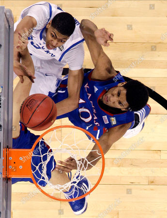 Kentucky forward Anthony Davis tries to shoot against Kansas guard Tyshawn Taylor (10) during the second half of the NCAA Final Four tournament college basketball championship game, in New Orleans