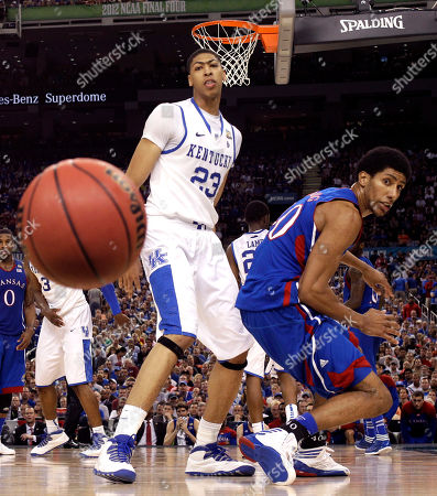 Kentucky forward Anthony Davis (23) and Kansas guard Tyshawn Taylor (10) watch the ball go by during the second half of the NCAA Final Four tournament college basketball championship game, in New Orleans