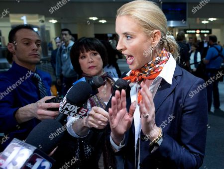Broadcast journalist Laurie Dhue talks with members of the media after arriving at McCarran International Airport, in Las Vegas. Dhue was a passenger on board Jet Blue flight 191 from New York JFK when it was diverted to Amarillo, Texas after the captain stormed through the plane rambling about a bomb and threats from Iraq Tuesday until passengers on the Las Vegas-bound flight tackled him to the ground just outside the cockpit