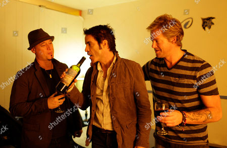 Patrick Monahan, Jimmy Stafford, Scott Underwood From left, Jimmy Stafford, Patrick Monahan, and Scott Underwood of the band Train sample some of their wine before their concert at the Great American Music Hall in San Francisco