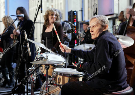 "5 Levon Helm, right, performs with his band on the ""Imus in the Morning"" program on the Fox Business channel, in New York. At center is his daughter Amy Helm. A message posted on the 71-year-old musician's website by his family says ""Levon is in the final stages of his battle with cancer."" Helm was diagnosed with throat cancer in 1998 and the illness reduced his voice to a whisper. But he still continued to sing on albums and at rollicking concerts at his Woodstock home. Helm was a key member of The Band and lent his distinctive Southern voice to classics like ""The Weight"" and ""The Night They Drove Old Dixie Down"