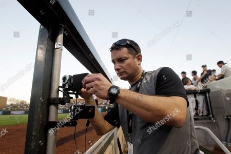 Danny Martin, Todd Helton Danny Martin, coordinator of video systems for the San Francisco Giants, sets up cameras in the dugout to monitor pitchers and batters before a spring training baseball game against the Colorado Rockies in Scottsdale, Ariz. Baseball is finally embracing the technological revolution, turning more and more to video and other modern devices instead of relying on what someone sees with their own eyes