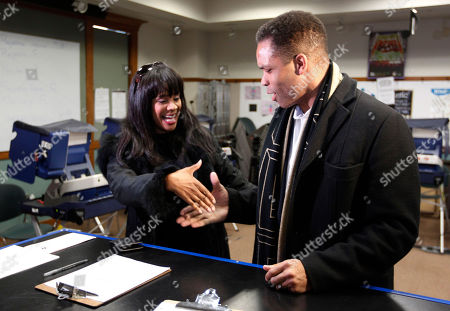 U.S. Rep. Jesse Jackson Jr., Sandi Jackson U.S. Rep. Jesse Jackson Jr. and his wife, Chicago Alderman Sandi Jackson, ask each other for their support and votes as they arrive at a polling station for early voting, in Chicago. Jackson is facing opposition for his 2nd congressional district seat in the upcoming primary from former U.S. Congresswoman Debbie Halvorson