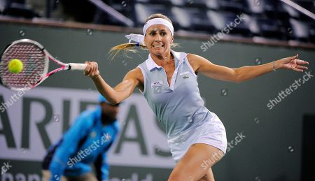 Gisela Dulko Gisela Dulko, of Argentina, returns a shot to Maria Sharapova, of Russia, during their match at the BNP Paribas Open tennis tournament, in Indian Wells, Calif