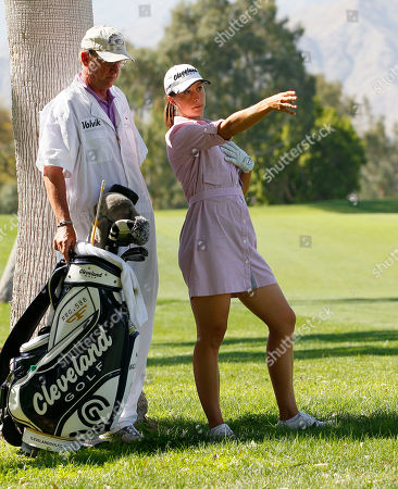 Paige Mackenzie Paige Mackenzie lines up her shot on the 18th fairway during the first round of the Kraft Nabisco Championship golf tournament, in Rancho Mirage, Ca