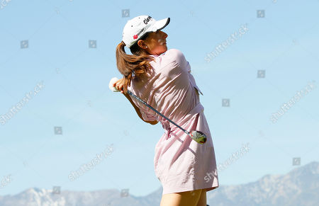 Paige Mackenzie Paige Mackenzie hits from the 18th tee during the first round of the Kraft Nabisco Championship golf tournament, in Rancho Mirage, Ca