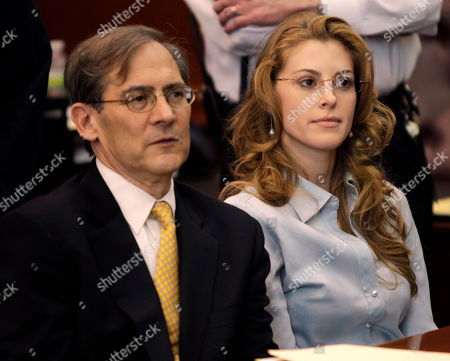 Jaynie Mae Baker, Robert Gottlieb Jaynie Mae Baker sits with her lawyer Robert Gottlieb for her arraignment in State Supreme Court, in New York. Baker is accused of working for a high-priced brothel