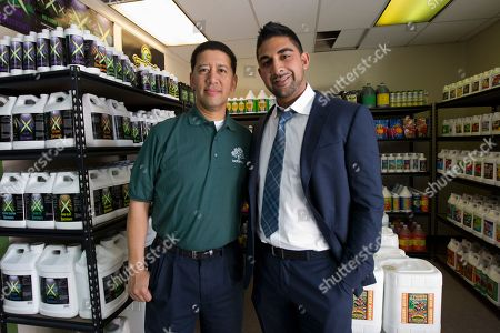 "Dhar Mann, Alex Wong WeGrow franchisee Alex Wong, left, and WeGrow founder Dhar Mann, right pose inside the WeGrow store in northeast Washington, as they prepare for its Friday opening. A company dubbed the ""Walmart of Weed"" is putting down roots in America's capital city, sprouting further debate on marijuana _ medical or otherwise. Just a few miles from the White House and federal buildings, a company that candidly caters to medical marijuana growers is opening up its first outlet on the East Coast. The opening of the weGrow store on Friday in Washington coincides with the first concrete step in implementing a city law allowing residents with certain medical conditions to purchase pot"