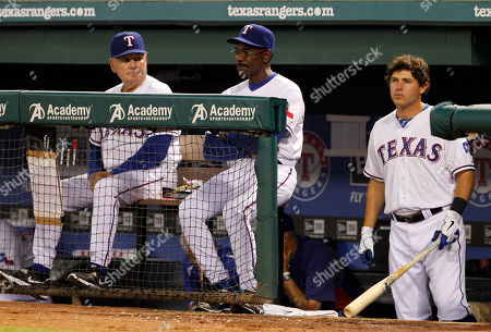 Jackie Moore, Ron Washington, Ian Kinsler Texas Rangers' bench coach Jackie Moore, from left, manager Ron Washington and Ian Kinsler, right, during a baseball game against the Seattle Mariners, in Arlington, Texas. The Mariners won 4-3