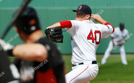 Stock Picture of Andrew Bailey, Chris Coghlan Boston Red Sox pitcher Andrew Bailey delivers against to Miami Marlins Chris Coghlan during the sixth inning of a spring training baseball game in Fort Myers, Fla