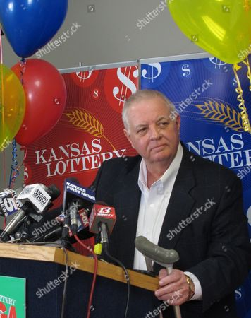 Dennis Wilson, executive director of the Kansas Lottery, answers questions about the Kansas resident claiming a share of a $656 million Mega Millions jackpot, during a news conference, at lottery headquarters in Topeka, Kan. The winner from Kansas wants to remain anonymous