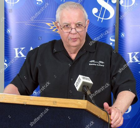 Dennis Wilson, the Kansas Lottery's executive director, answers questions from reporters about the winning Mega Millions ticket sold in northeast Kansas, in Topeka, Kan. Winning tickets were sold in Kansas, Illinois and Maryland for a share of an estimated $640 million jackpot