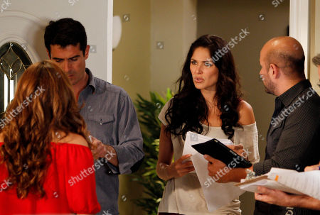 "Stock Photo of Blanca Soto, Rafael Novoa, Carlos Perez Santos Actress Blanca Soto, second from right, actor Rafael Novoa, second left, and Karyme Lozano, back to camera, in red, work with scene director Carlos Perez Santos, right, as they rehearse for the telenovela or soap opera ""El Talisman,"" at the Venevision Studios in Medley, Florida"