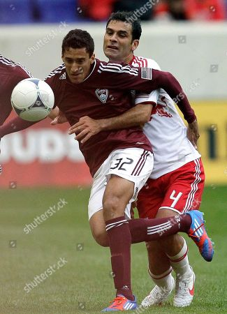 Rafa Marquez, Tony Cascio Colorado Rapids's Tony Cascio (32) and New York Red Bulls's Rafa Marquez (4) get tangled up while competing for the ball in the second half of an MLS soccer game, in Harrison, N.J. The Red Bulls won 4-1
