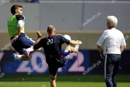 Ryan Maduro, Joel Lindpere, Hans Backe New York Red Bulls' Ryan Maduro, left, leaps for the ball against teammate Joel Lindpere, center, as head coach Hans Backe looks on during a workout at the team's MLS soccer media day, in Harrison, N.J
