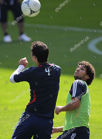 Rafa Markez, Mehdi Ballouchy New York Red Bulls' Rafa Marquez, left, and Mehdi Ballouchy compete for the ball during a workout at the team's MLS soccer media day, in Harrison, N.J