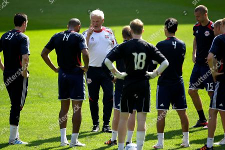 Hans Backe New York Red Bulls' head coach Hans Backe, center left, talks to his team during a workout at the team's MLS soccer media day, in Harrison, N.J