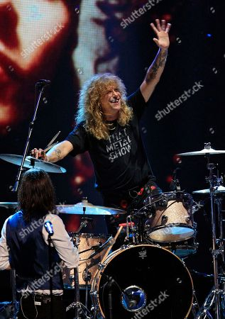 Steven Adler Guns N' Roses drummer Steven Adler waves during a performance after the band's induction into the Rock and Roll Hall of Fame early, in Cleveland