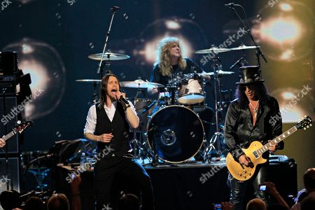 Myles Kennedy, Slash Myles Kennedy, left, performs with Guns N' Roses' Slash, right, and drummer Steven Adler at the 2012 Rock and Roll Hall of Fame inductions, in Cleveland