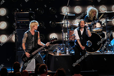 Duff McKagan, Steven Adler, Myles Kennedy Guns N' Roses members Duff McKagan, left, and drummer Steven Adler perform with Myles Kennedy at the 2012 Rock and Roll Hall of Fame inductions, in Cleveland