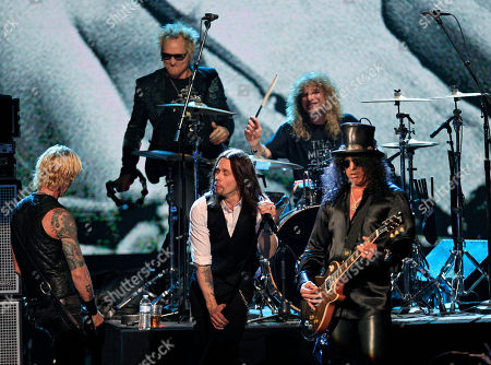 Duff McKagan, Matt Sorum, Steven Adler, Slash, Myles Kennedy Guns N' Roses' Duff McKagan, left, Matt Sorum, top left, Steven Adler, top right, and Slash, right, perform with guest vocalist Myles Kennedy after induction onto the Rock and Roll Hall of Fame, in Cleveland