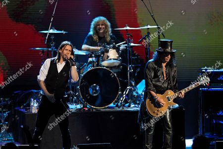 Stock Photo of Slash, Steven Adler, Myles Kennedy Guns N' Roses' Slash, right, and Steven Adler on drums, perform with singer Myles Kennedy, left, after induction into the Rock and Roll Hall of Fame, in Cleveland